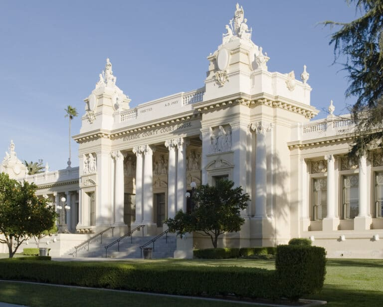 A photo of the Riverside County Courthouse in Riverside, California. Designed by the Los Angeles architectural firm of Burnham & Bliesner, the RIverside courthouse, a Beaux Arts structure was completed in 1904. The Riverside County Courthouse extensively renovated in the 1990s.